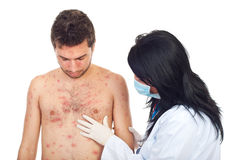 Doctor examine man skin rash. Doctor woman with mask and gloves examine  skin rash to a man with chickenpox isolated on white background Stock Image