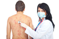 Doctor examine patient with chickenpox. Doctor woman examine patient male with chickenpox isolated on white background Stock Photos