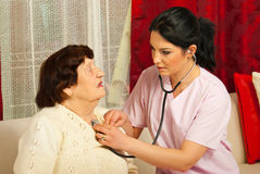 Doctor examine patient home. Doctor women examine senior patient women home Royalty Free Stock Photos