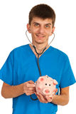 Doctor examine piggybank Royalty Free Stock Photos