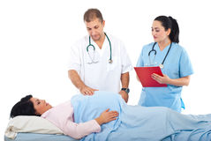 Doctor examine pregnant belly Stock Image