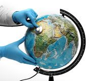 Doctor examine with stetoscope the ill Earth Stock Photo
