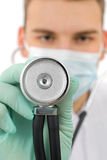 The doctor examine whit the stethoscope. The young doctor examine whit the stethoscope Stock Images