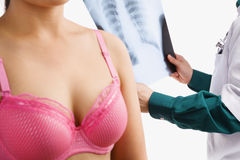 Doctor examine xray with woman on pink bra Stock Photos