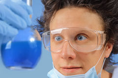 Doctor examines flask Stock Images