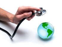 Doctor examines health of the Earth. Concept for world healthcare, looking after the planet. Isolated on white Royalty Free Stock Images