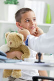 Doctor examines little boy Stock Photos
