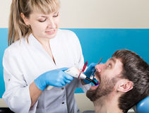 Doctor examines the oral cavity on tooth decay. Caries protection. Tooth decay treatment. Dentist working with dental. The reception was at the female dentist Royalty Free Stock Photos