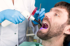 Doctor examines the oral cavity on tooth decay. Caries protection. Tooth decay treatment. Dentist working with dental. The reception was at the female dentist Royalty Free Stock Image