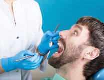 Doctor examines the oral cavity on tooth decay. Caries protection. Tooth decay treatment. Dentist working with dental. The reception was at the female dentist Stock Photos