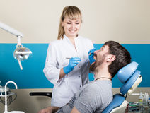 Doctor examines the oral cavity on tooth decay. Caries protection. Tooth decay treatment. Dentist working with dental. The reception was at the female dentist Stock Images