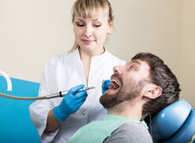 Doctor examines the oral cavity on tooth decay. Caries protection. Tooth decay treatment. Dentist working with dental. The reception was at the female dentist Royalty Free Stock Photography