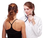 Doctor Examines Patient. Royalty Free Stock Image
