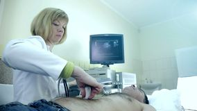 Doctor examines a patient`s heart with ultrasound. Diagnostics and Ultrasound examination of the patient.  stock footage