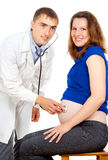 Doctor examines a pregnant girl Stock Photos