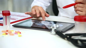 Doctor Examines An X-ray Images. Of Patient On Digital Tablet stock video
