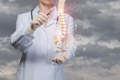 The doctor examines the spine of the man. Against the sky stock photo
