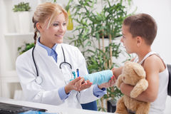 Doctor examines, young boy wearing a blue cast Royalty Free Stock Photos