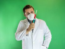 Doctor examing blood sample Stock Images