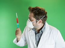 Doctor examing blood sample Royalty Free Stock Photography