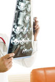 Doctor Examining A CAT Scan Royalty Free Stock Photo