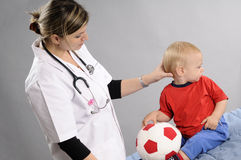 Doctor Examining Baby Boy Royalty Free Stock Image