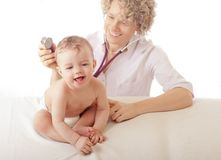 Doctor examining baby boy Royalty Free Stock Photography