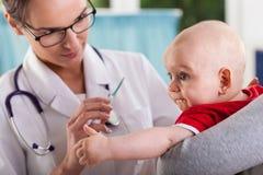 Doctor examining a baby Royalty Free Stock Photos