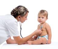 Doctor examining baby girl isolated on white Stock Image