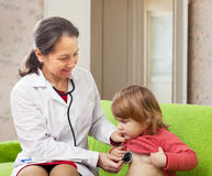 Doctor examining baby with  phonendoscope Royalty Free Stock Photo