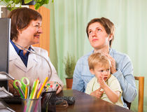 Doctor examining baby Royalty Free Stock Images