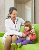 Doctor examining  baby with  stethoscope Stock Photography