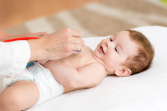 Doctor examining baby with stethoscope Royalty Free Stock Image