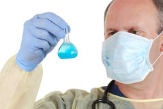 Doctor examining blue laboratory sample Royalty Free Stock Image