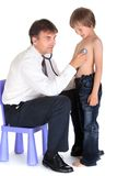 Doctor examining boy Royalty Free Stock Photos