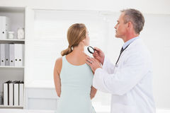 Doctor examining a brown spot Stock Photography
