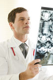 Doctor Examining a CAT scan Royalty Free Stock Photography