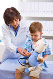 Doctor examining child stock image