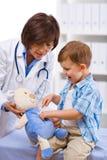 Doctor examining child Royalty Free Stock Photo