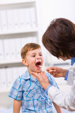 Doctor examining child Stock Photos