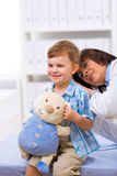 Doctor examining child Stock Photos