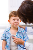 Doctor examining child Stock Images