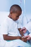 Doctor examining a child Royalty Free Stock Photo