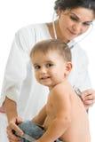 Doctor examining child isolated on white Stock Image