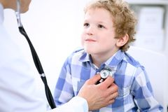 Doctor examining a child  patient by stethoscope Stock Image