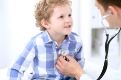 Doctor examining a child  patient by stethoscope Royalty Free Stock Photos
