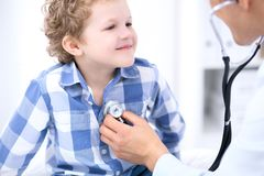 Doctor examining a child  patient by stethoscope Stock Images