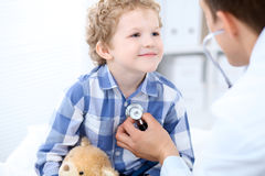 Doctor examining a child  patient by stethoscope Royalty Free Stock Image