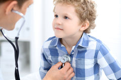 Doctor examining a child  patient by stethoscope Stock Photo