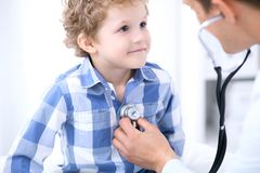Doctor examining a child  patient by stethoscope Royalty Free Stock Images